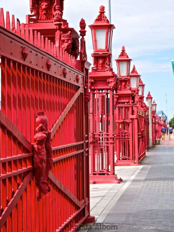 Red fence along the coastline at the Port of Auckland in New Zealand