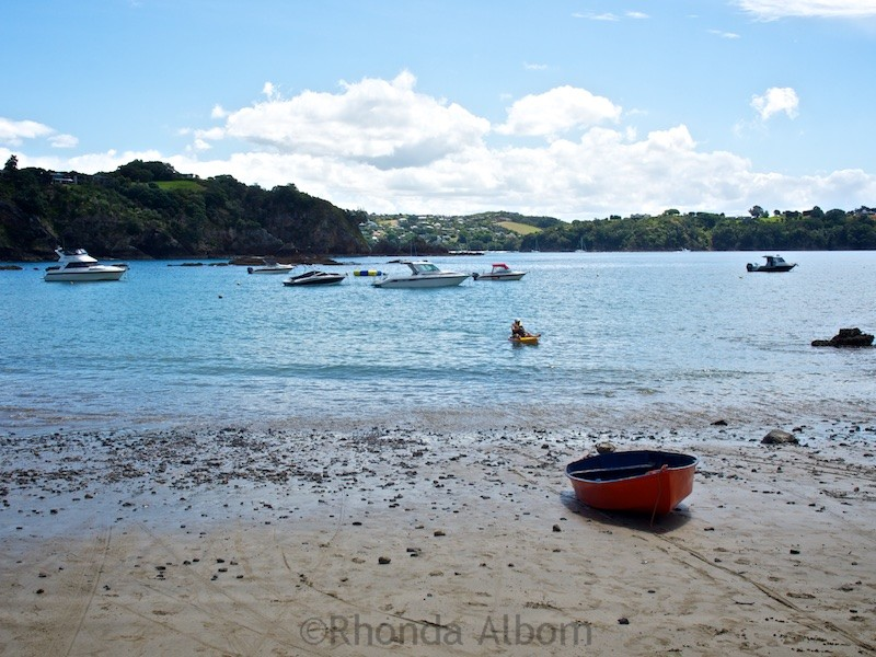 Sandy Bay is one of many Waiheke Island beaches near Auckland New Zealand