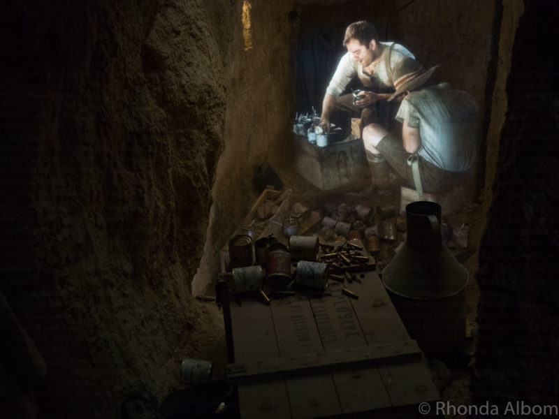 "A ""hologram"" of a soldier makes hand grenades from empty food tins, shrapnel and explosives inside the new Quinn's Post Trench Experience at The Great War Exhibition in Wellington New Zealand"