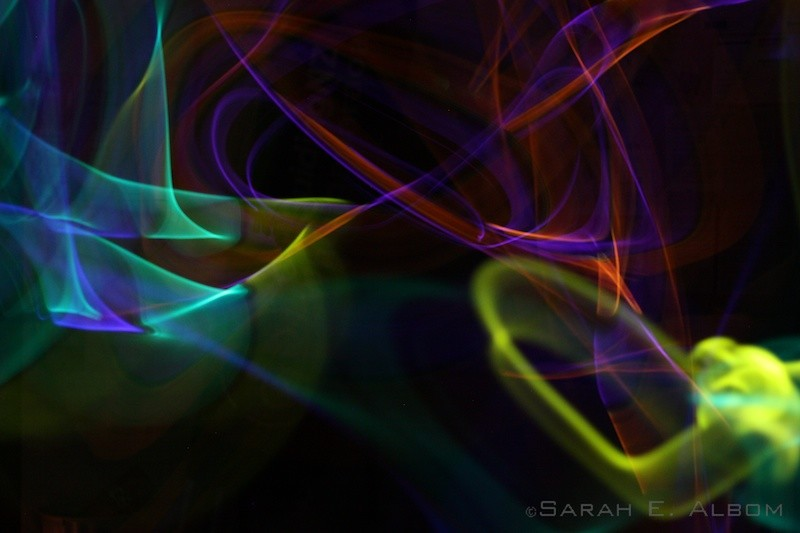 Long exposure photography of glowsticks in Auckland, New Zealand. Copyright Sarah E. Albom 2014; for more New Zealand photos, visit the blog