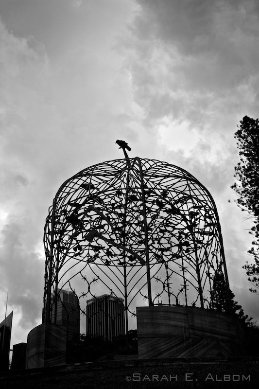 A black and white photo of a bird sitting atop a sculpture in the Sydney Botanical Gardens in Australia. Copyright Sarah E. Albom 2015; for more photos of Australia, visit the blog