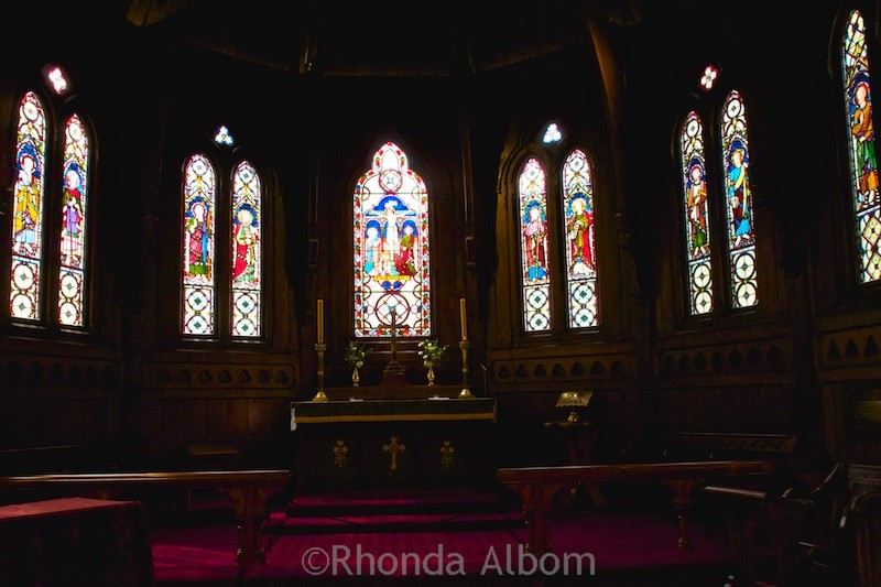 Stained glass windows inside Old St Paul Cathedral in Wellington New Zealand