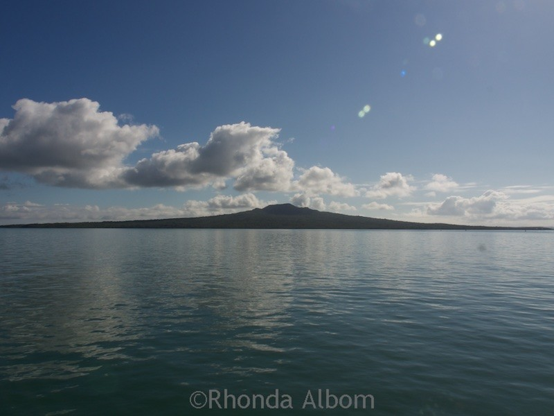 Rangitoto Island seen from Auckland. Kayaking from here Rangitoto is one of the many places to visit in Auckland  at night.