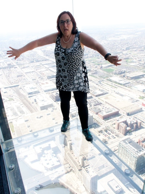 Having a bit of fun out on the ledge of Skydeck Chicago, USA