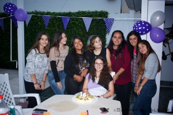 A few of my school friends and a cousin at my 16th birthday party. In Argentina, parties normally occur from about 9:30pm till dawn, but I decided to have an afternoon party as I didn't feel up to hosting an all-night party just yet. The cake in front of me is a pavlova - a traditional New Zealand cake made of eggs.