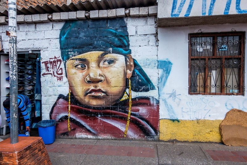 Street art in Otavalo Ecuador of a boy by Tenaz