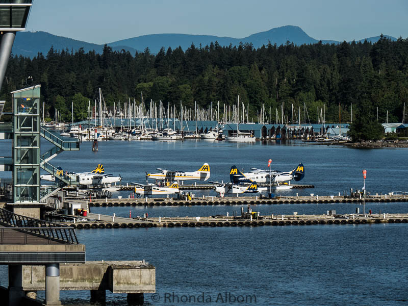 Seaplanes and boats at a marina in Vancouver Harbour