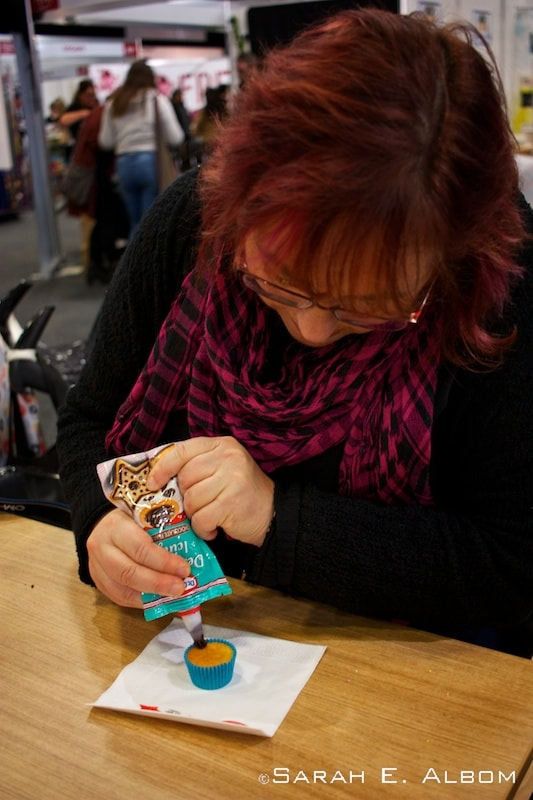 Decorating cupcakes at the XXX stall at the Auckland Food Show
