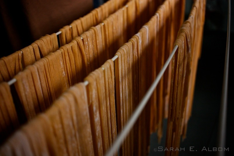 Homemade pasta on a rack, and common Argentinian food originated in Italy. Photo copyright ©Sarah Albom 2016