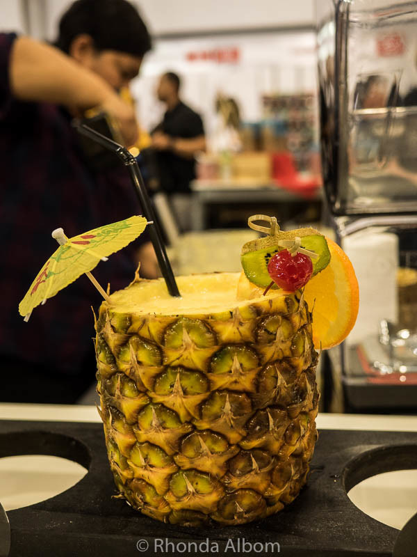 A fresh fruit smoothy in a pineapple cup at the Auckland Food Show 2016