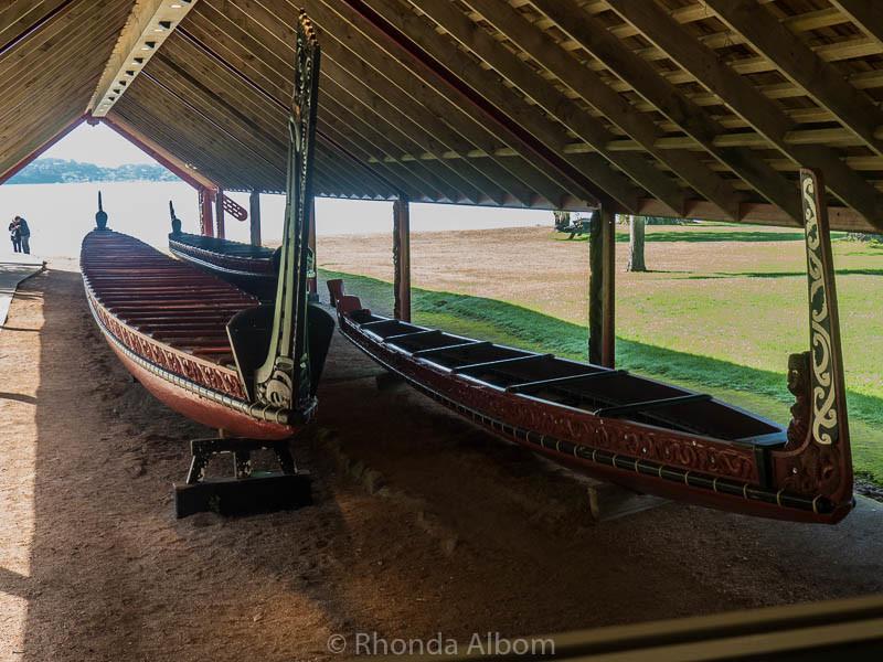 Three Maori waka taua (war canoes) in the waka house at Waitangi