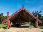 Intricately carved waka house, where the Maori war canoes are stored at the Waitangi Treaty Grounds.