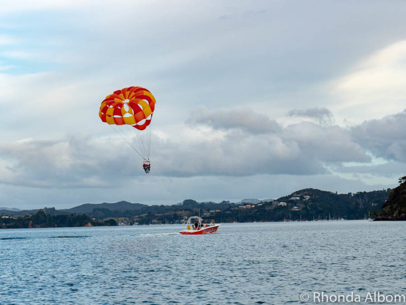 Parasailing is one of the many water sport activities in Bay of Islands New Zealand