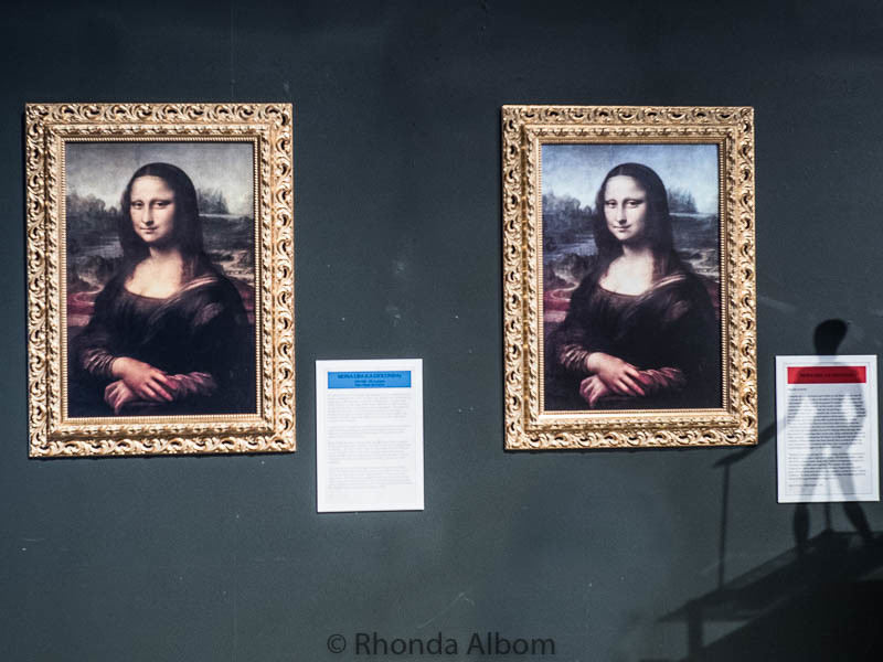 Two copies of the Mona Lisa hang side by side at MOTAT in Auckland New Zealand