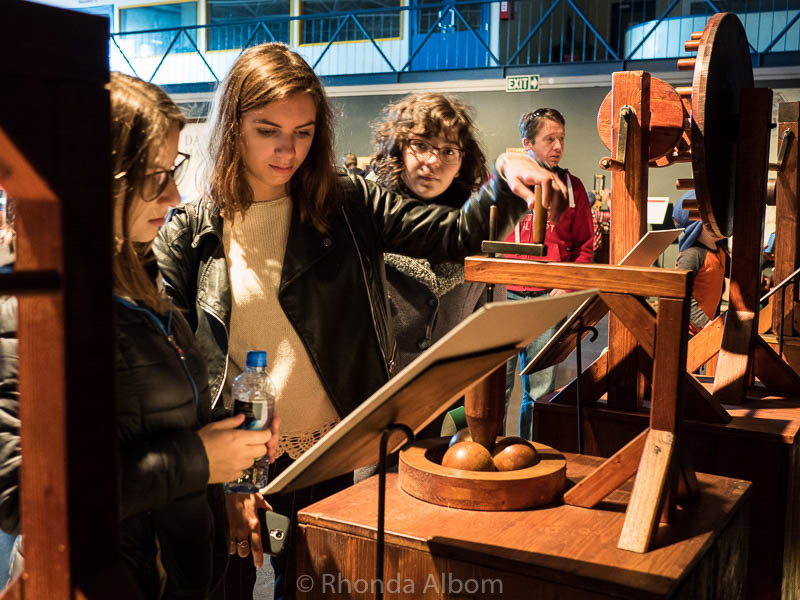 Teens trying out some of Leonardo da Vinci's Machines at MOTAT in Auckland New Zealand