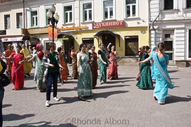 Hare Krishnas dancing and parading down Arbat Street in Moscow Russia