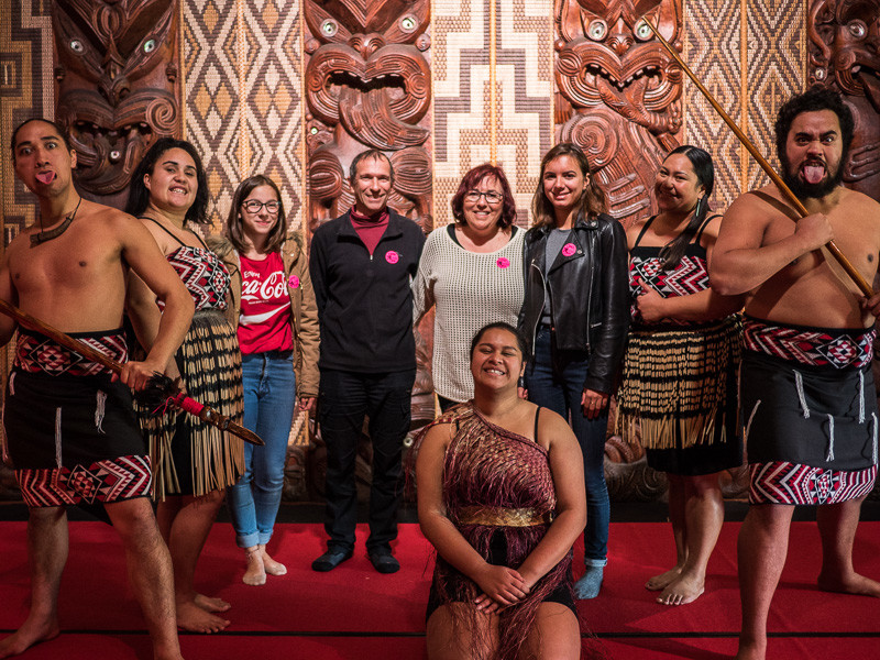 Photo with warriors at the Waitangi Treaty Grounds in New Zealand.