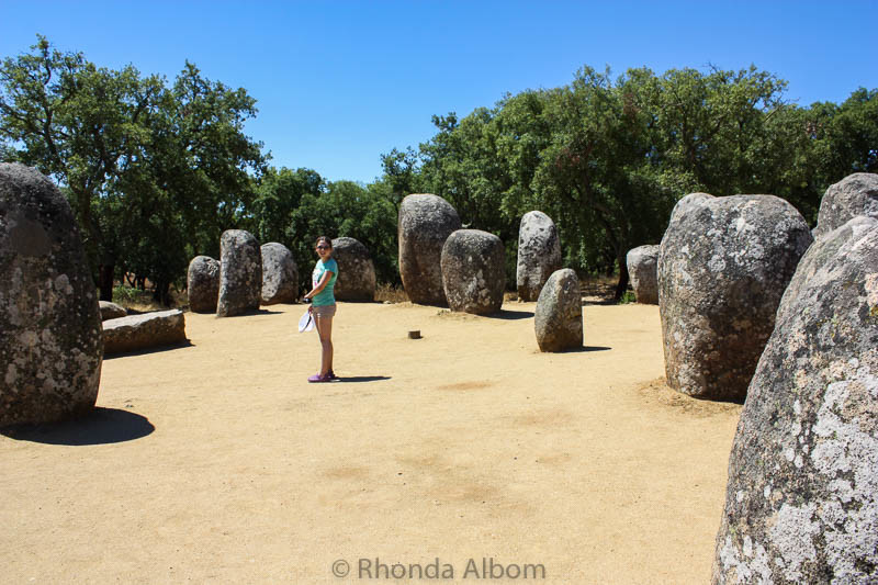 Standing in the center of the Almendres Cromlech megalithic complex in Evora Portugal