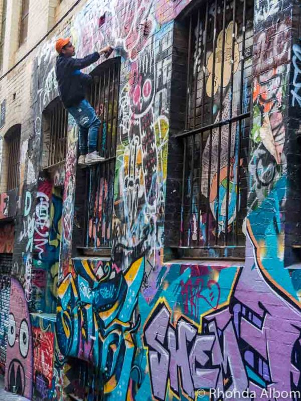 Street Artist painting on Hosier Lane in Melbourne Australia