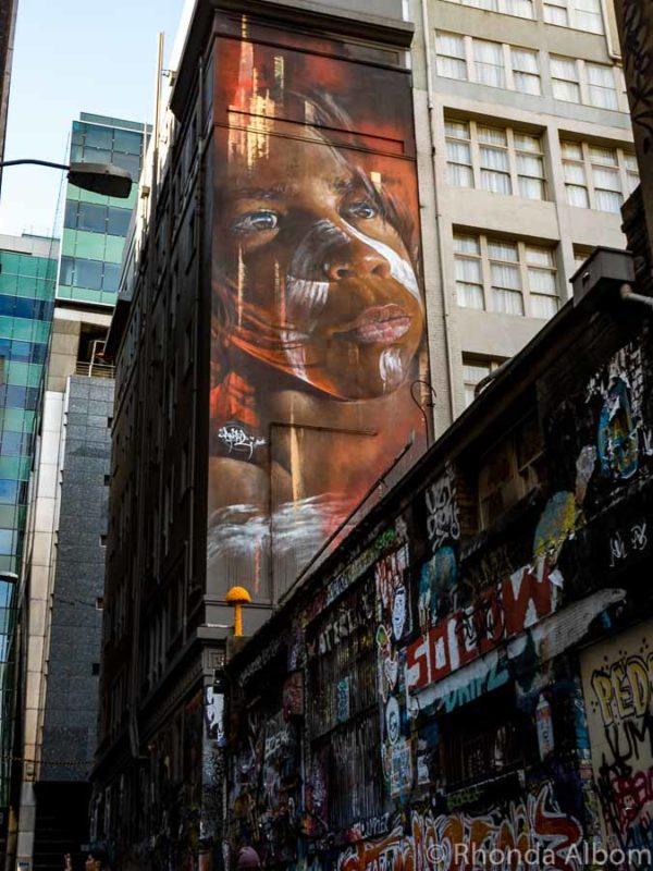 An aboriginal mural street artist Matt Adnate on Hosier Lane in Melbourne Australia