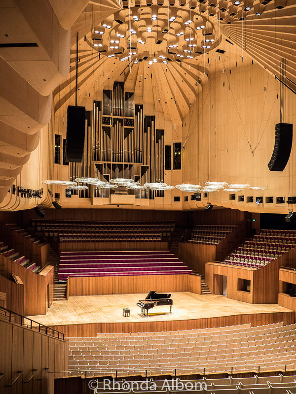 Concert Hall at Sydney Opera House hold 2700 inclucind 700 on stage. Designed for instumental sound.