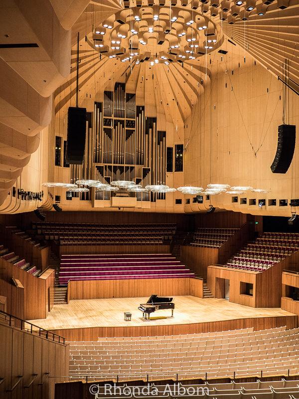 Concert Hall at Sydney Opera House hold 2700 inclucind 700 on stage. Designed for instumental sound.