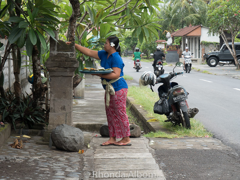 A women putting out the daily offering in Bali Indonesia