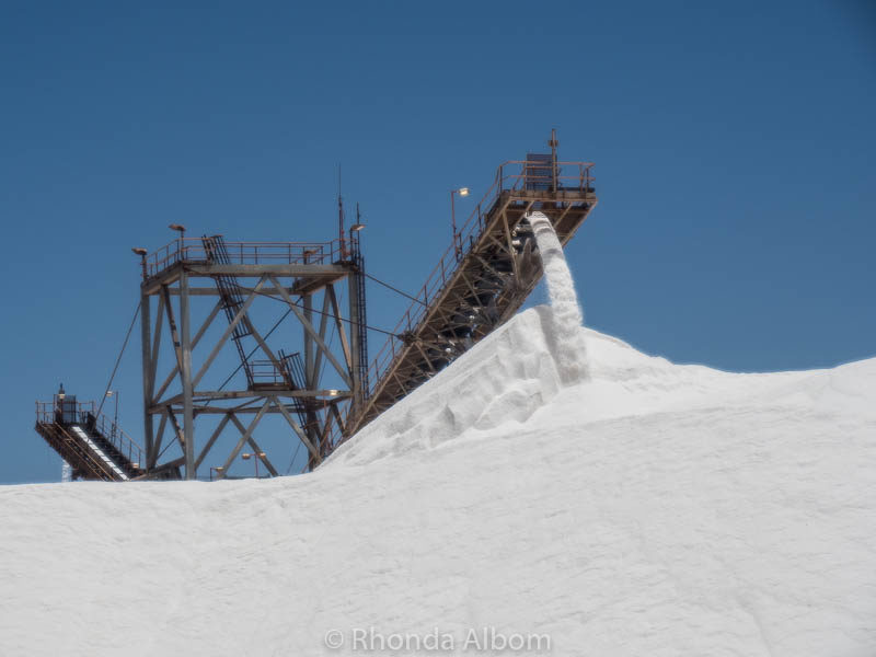 Industrial salt being loaded into mounds by Rio Tinto in Port Hedland, Australia