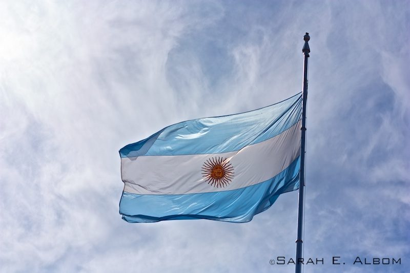 The Argentinian Flag flying over La Casa Rosada in Argentina.Photo copyright ©Sarah Albom 2016