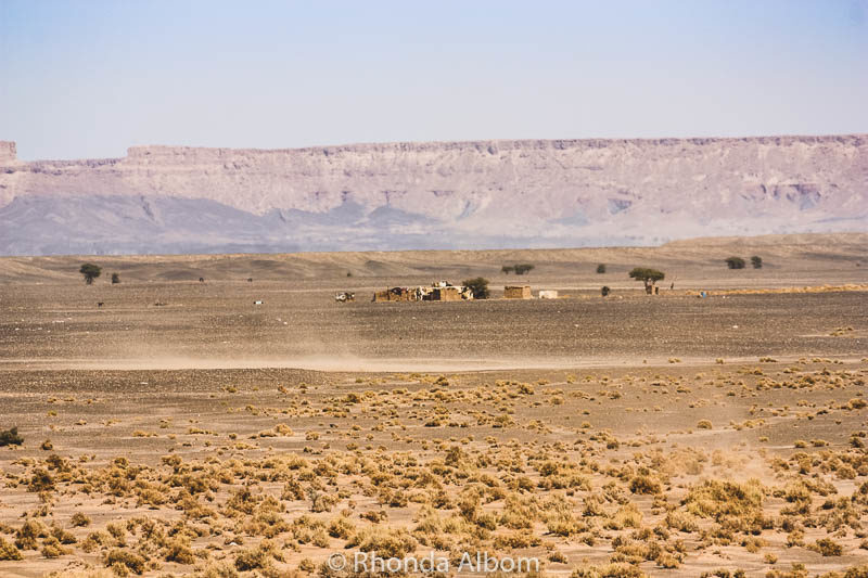 Our first view of a Bedouin camp in the distance in the Sahara desert in Morocco.