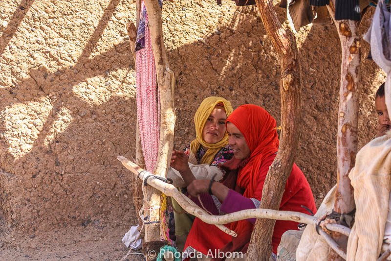 Bedouin women weaving a rug in Morocco