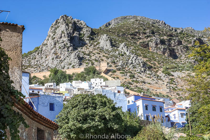 You can see the Chefchaouen's city wall as it runs up through the Rif Mountains.