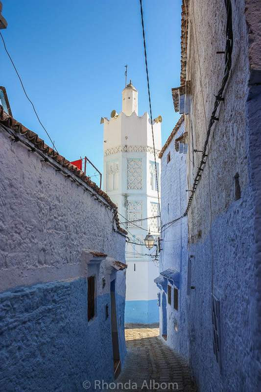 Mosque at the end of a narrow street in Chefchaouen in Morocco.