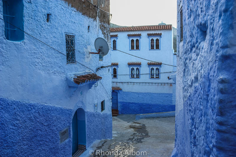 The contrast of new versus old is highlighted by the satellite dish on the side of one of the homes in Chefchaouen in Morocco.