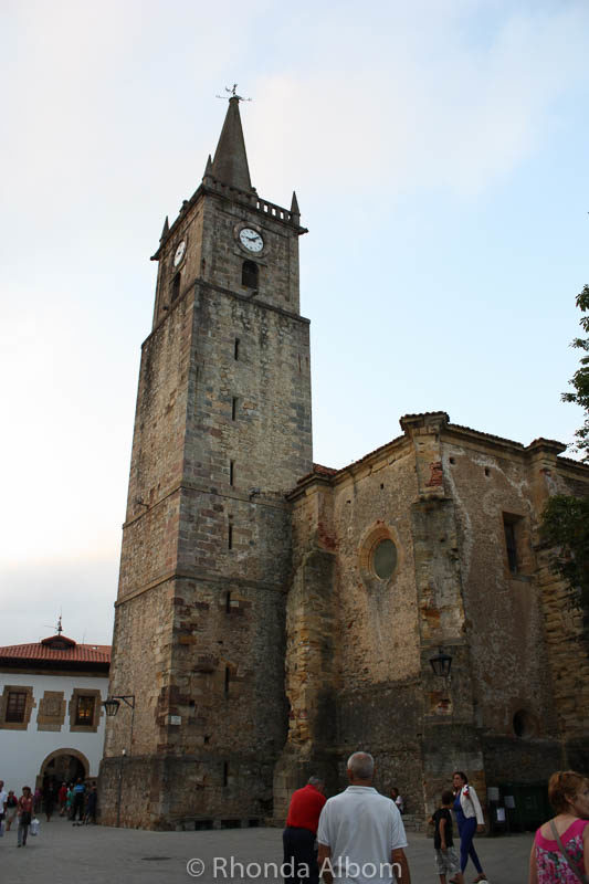 Clock on Iglesia de San Cristobal in Comillas, Cantabria, Spain