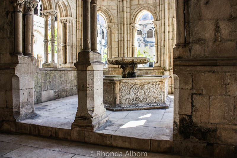 Renaissance water basin within the Gothic fountain house in the cloister of the Monastery of Alcobaça.