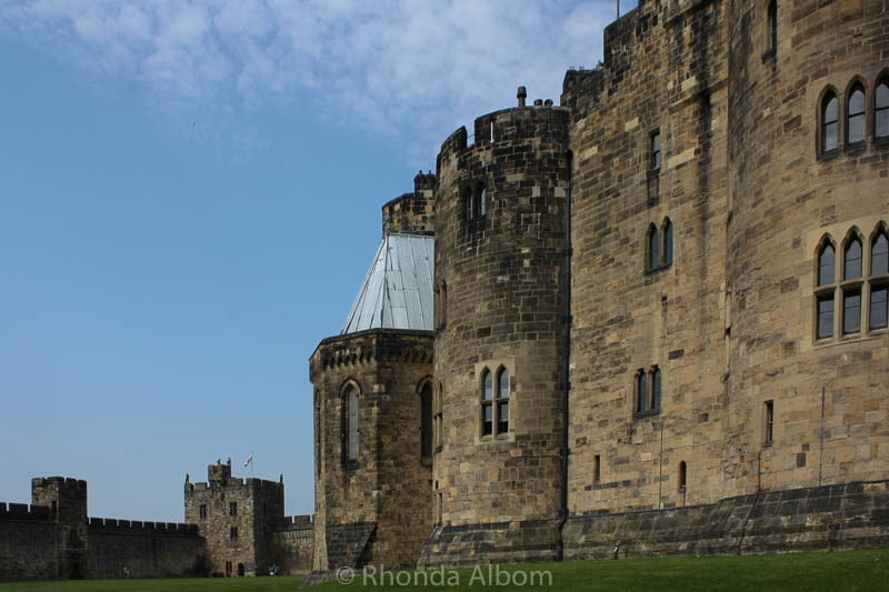 Alnwick Castle in England. It was used as Hogwarts in Harry Potter and used in Downton Abbey amongst others.