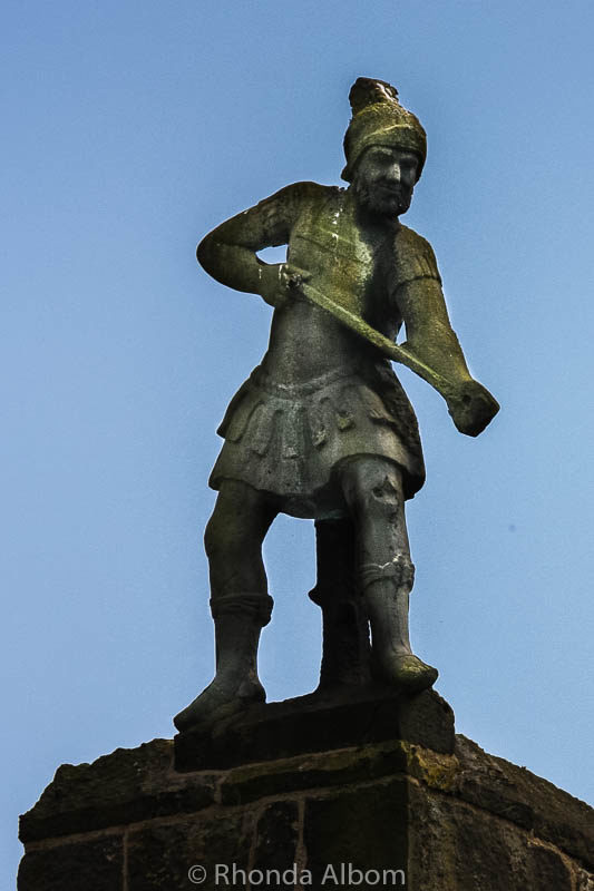 A figure on top of an Alnwick Castle tower in England
