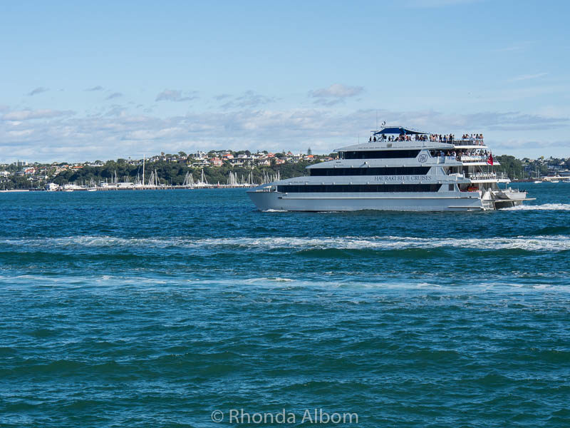 A sunset cruise heading out Devonport Wharf in Auckland New Zealand from