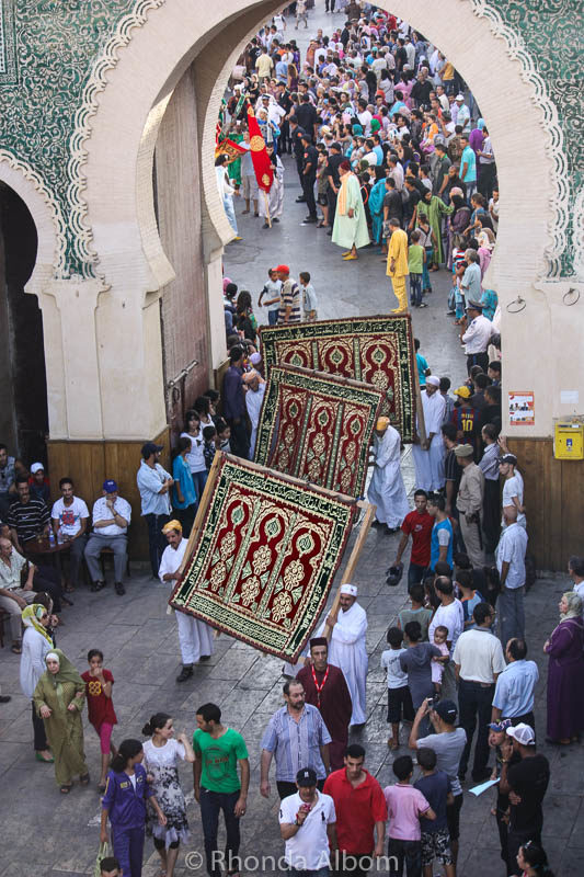 Artisans displaying carpets at the Moussem of Moulay Idriss II