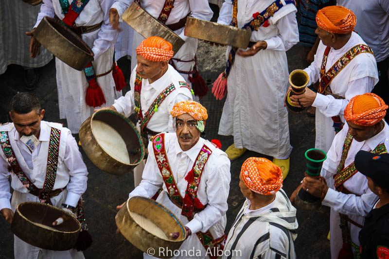 Drummer looking up at me during the parade of Moussem of Moulay Idriss II in Fes Morocco