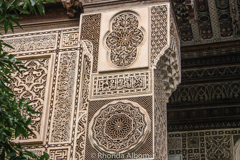 An intricately carved column and wall in El Bahia Palace in Marrakesh Morocco