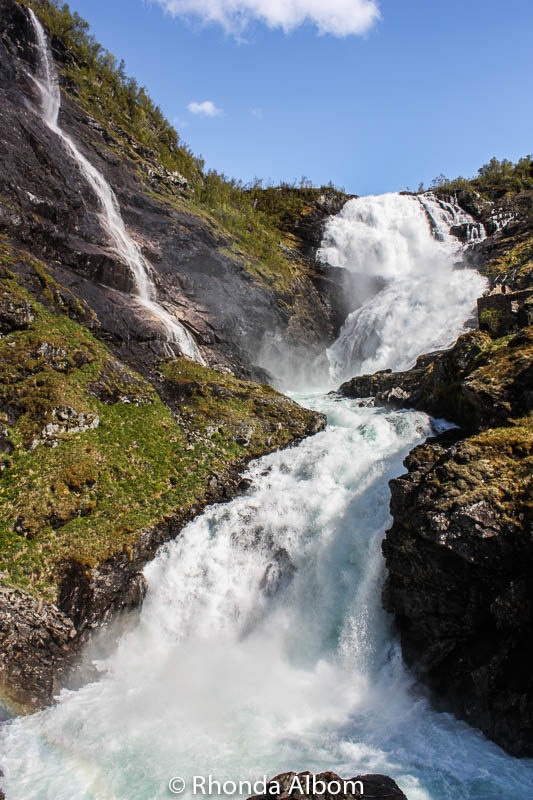 Kjosfossen Waterfall seen from a stop on the Flamsbana train from Voss back to Flaam