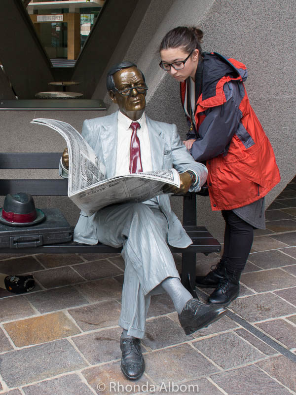 Man reading a newspaper sculpture in Sydney Australia