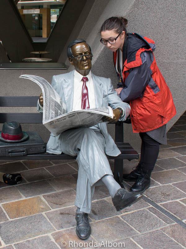 Man reading a newspaper sculpture in Sydney Australia