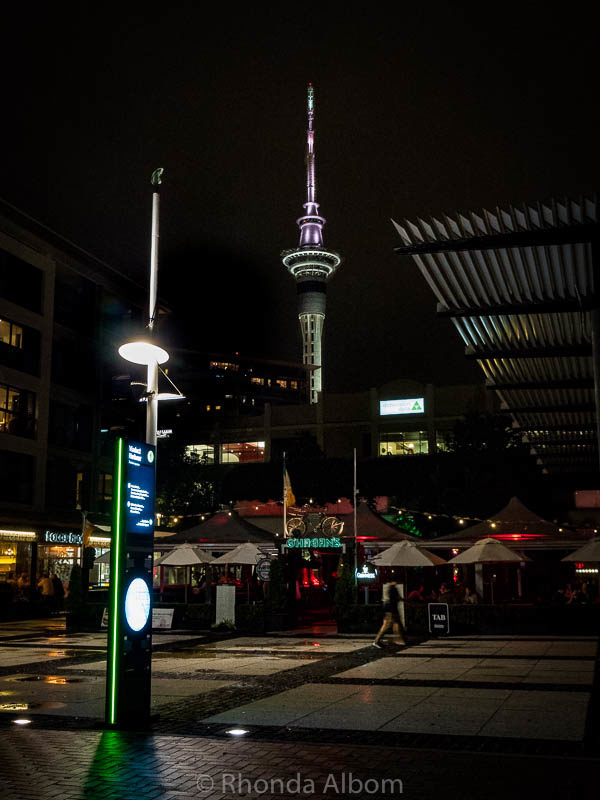 Sky Tower at night seen from Viaduct Harbour, Auckland, New Zealand
