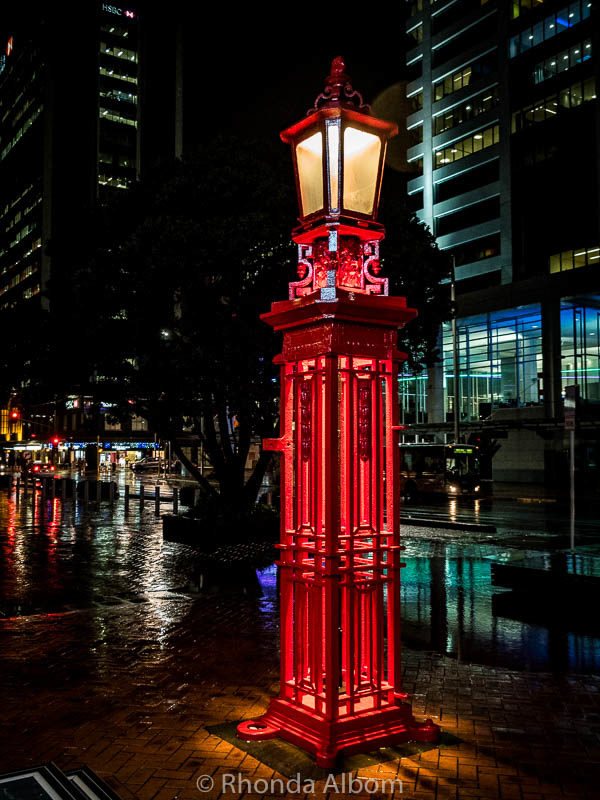 Lamps on Quay Street on a rainy night in Auckland New Zealand