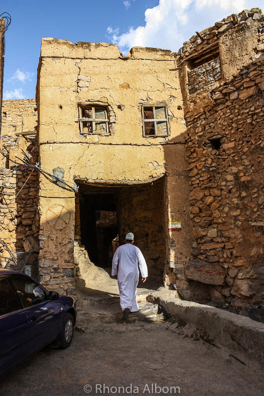 Our guide entering an alleyway in Misfat Oman