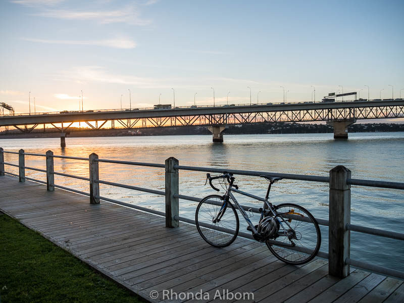 A bicycle leans against boardwalk fence in Auckland New Zealand