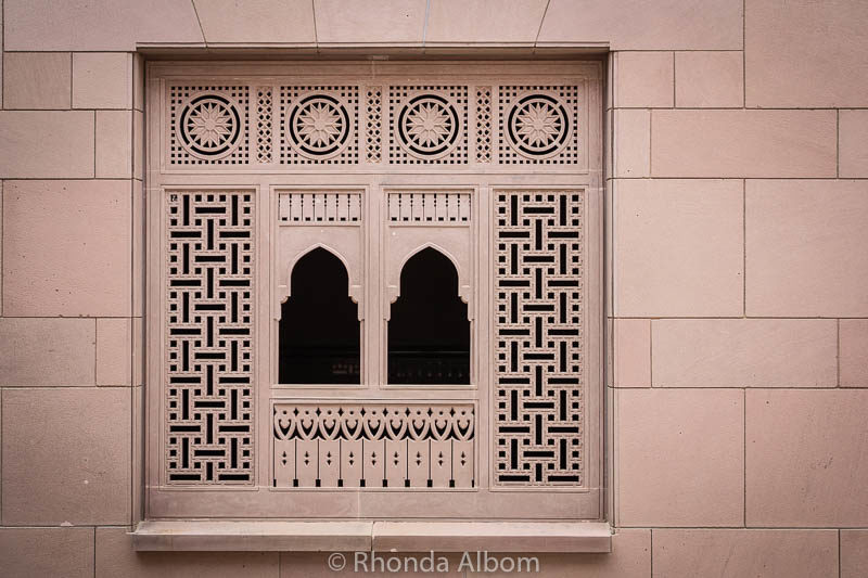 Intricately carved windows at the Sultan Qaboos Grand Mosque in Muscat Oman